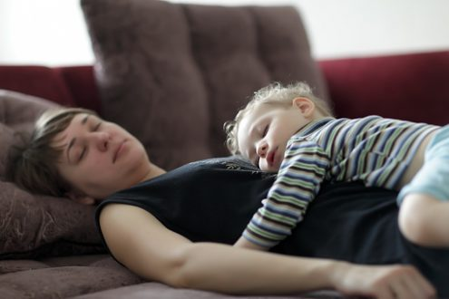 Sleeping mother and toddler