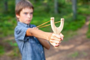 Kid with slingshot