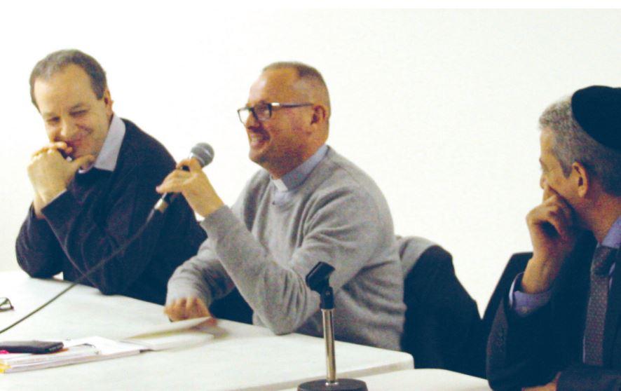 Le pasteur Serge Wüthrich en compagnie de prêtre, rabbin